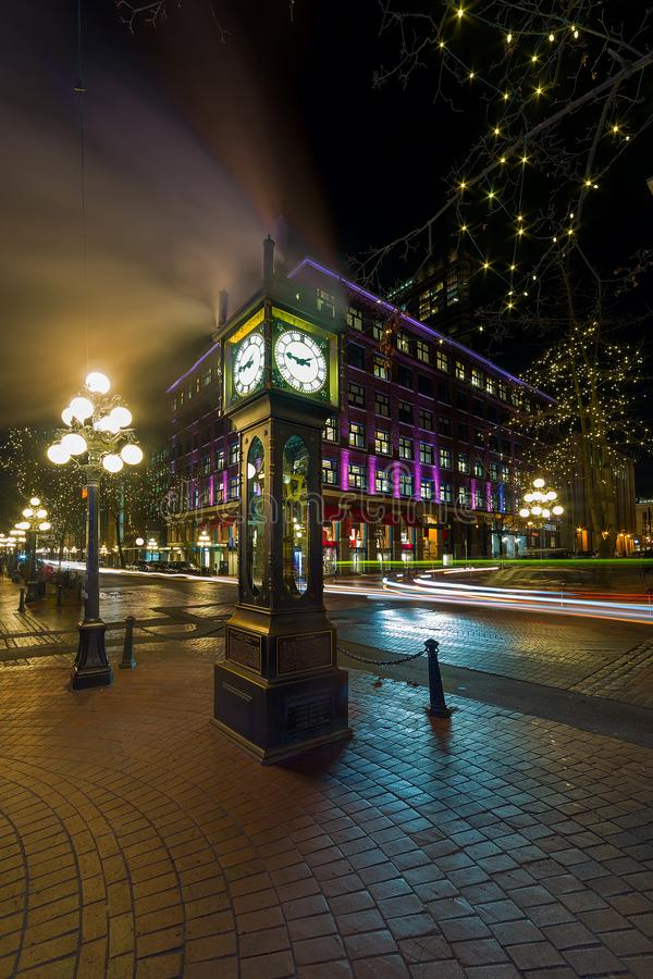 Steam Clock in Gastown Vancouver BC Canada at Night. Steam Clock in Gastown in Vancouver British Columbia Canada with cars light trails at night stock photo