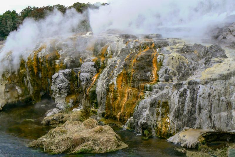 Steam and colorful rocks at Te Puia hot springs, Rotorua, New Zealand. Colorful steaming hot springs at Te Puia thermal park, Rotorua, New Zealand stock photos