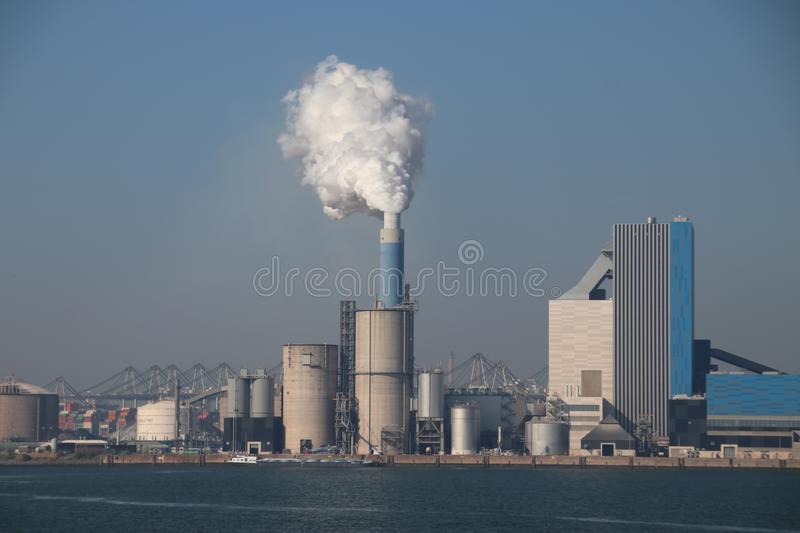 Steam comes out the chimney of the coal power plant of Engie in the Rotterdam Maasvlakte harbor in The Netherlands.  royalty free stock photography