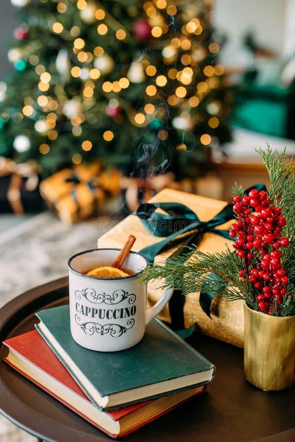 Steam cup hot tea lemon cinnamon christmas royalty free stock photography