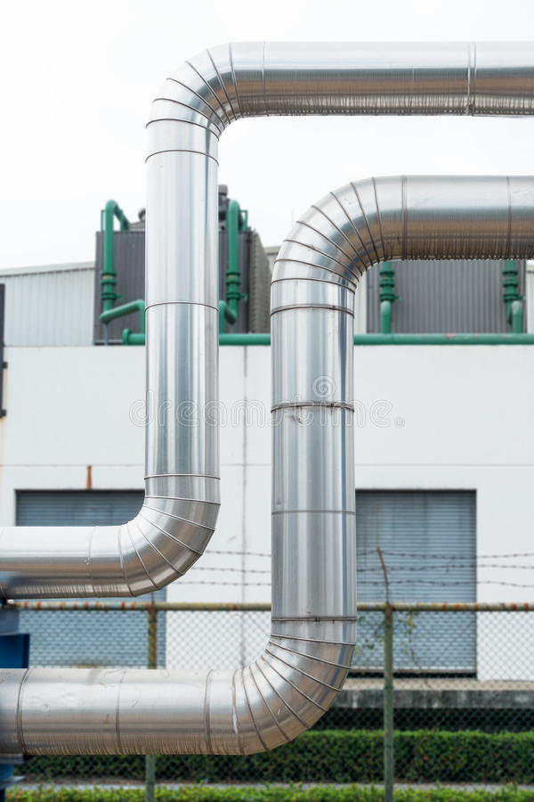 Steam distribution pipeline and insulation cover., Business industrial. royalty free stock photo