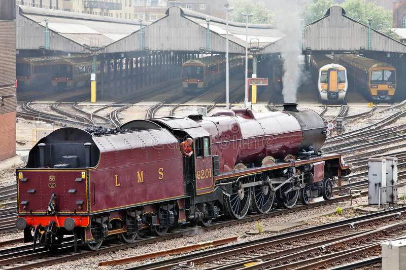 Download Steam and Electric trains editorial photo. Image of event - 23217276