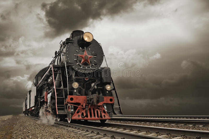 Steam engine and carriages in full steam. Steam engine and carriages, in full steam royalty free stock images