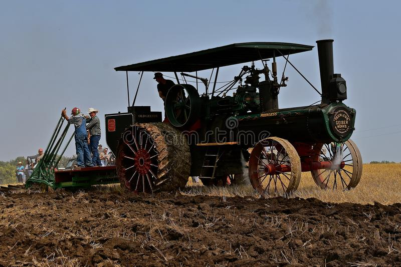 Steam engine gang plowing. ROLLAG, MINNESOTA, Sept 2, 2017: A Peerless Geiser Works steam engine demonstrates gan plowing at the annual WCSTR farm show in Rollag stock photography