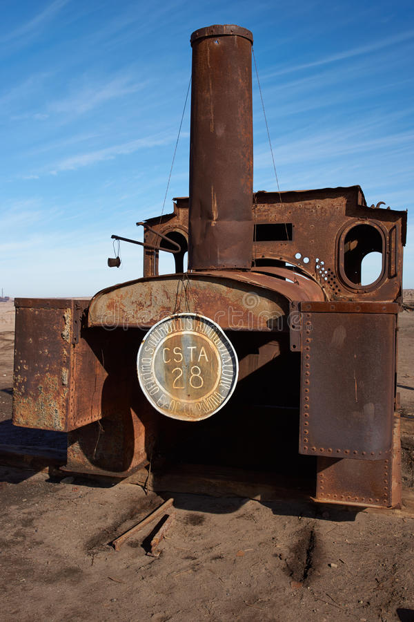 Steam Engine at the Humberstone Saltpeter Works. Derelict and rusting steam train at the historic Humberstone Saltpeter Works in the Atacama Desert near Iquique stock photo