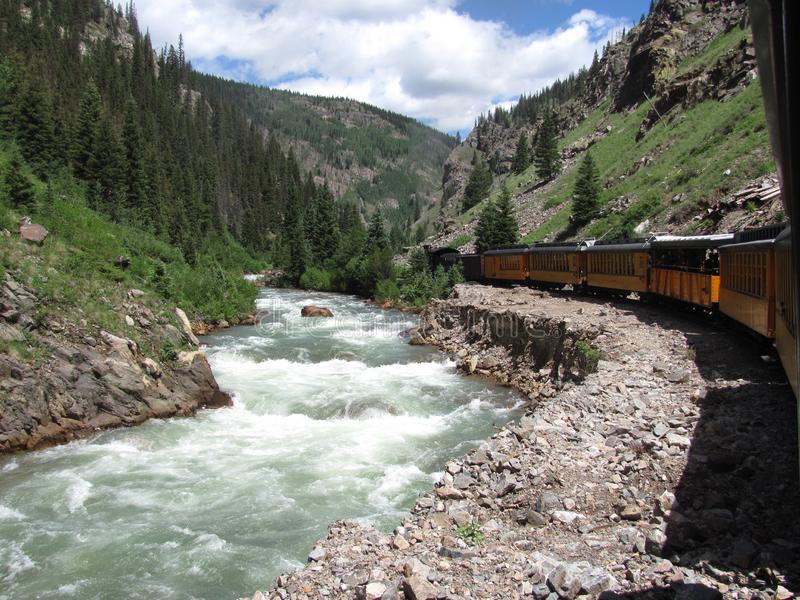 Steam engine train traveling from Durango to Silverton Colorado along the Animas river royalty free stock photography