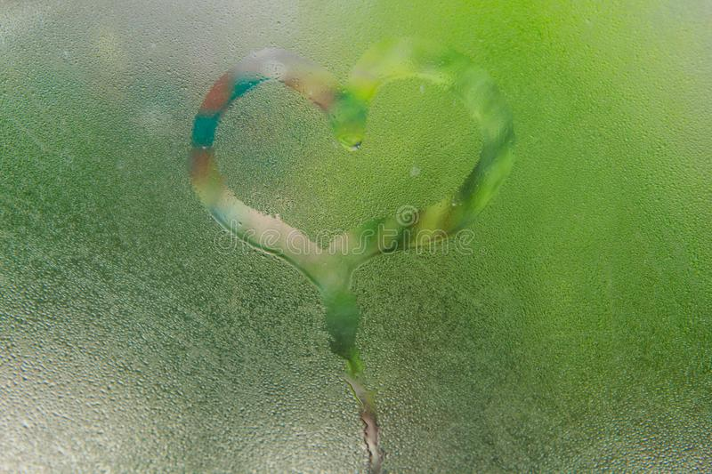 Steam on glass caused by moisture. And heart-shaped background stock images