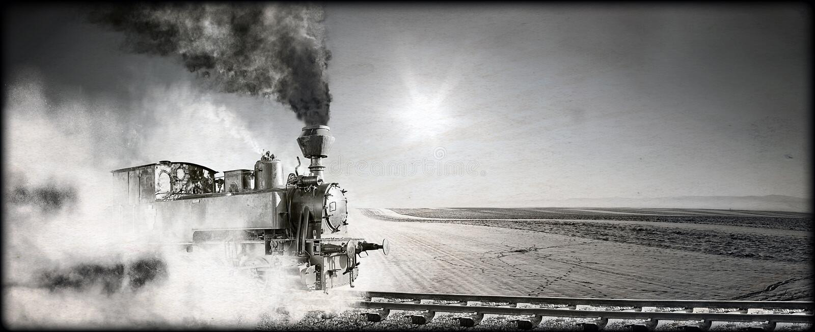 Steam locomotive. At the railway wrapped up in cloud - vintage retro tinting