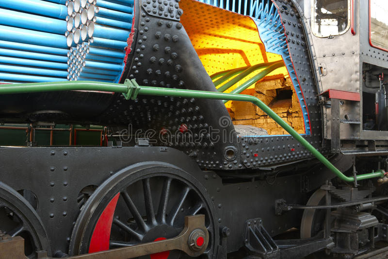 Steam locomotive with boiler section interior detail and pipes stock image