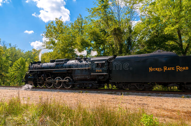 Steam locomotive. BRECKSVILLE, OH - SEPTEMBER 7, 2014: A steam locomotive on the Cuyahoga Valley Scenic Railroad waits for departure on an excursion run during royalty free stock image