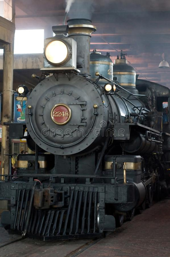 Steam locomotive in depot royalty free stock photography