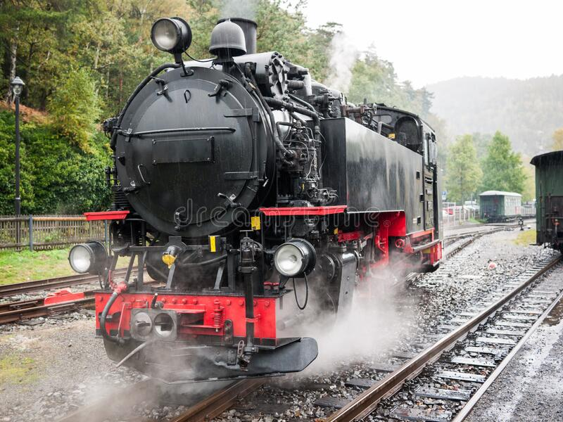 Steam locomotive of the narrow-gauge railway stock photo