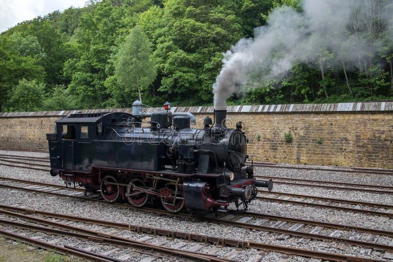 Steam locomotive. Retro vintage steam locomotive on rail tracks royalty free stock images