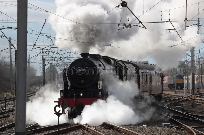 Steam locomotive 46115 Scots Guardsman, Carnforth. Preserved steam locomotive 46115 Scots Guardsman leaving Carnforth and heading onto the West Coast Main Line royalty free stock images