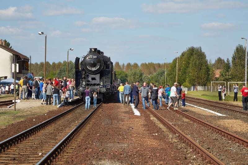 Steam locomotive at station. DABAS, HUNGARY - SEPTEMBER 28, 2014: Steam train on the 125th anniversary, of the opening of Lajosmizse line royalty free stock photo