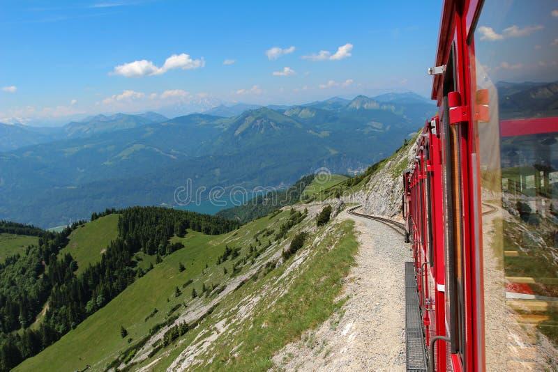 Beautiful mountain scenery in the Austrian Alps. Steam locomotive of a vintage cogwheel railway going to Schafberg, Wolfgangsee. Schafberg Peak - 1783m royalty free stock photos