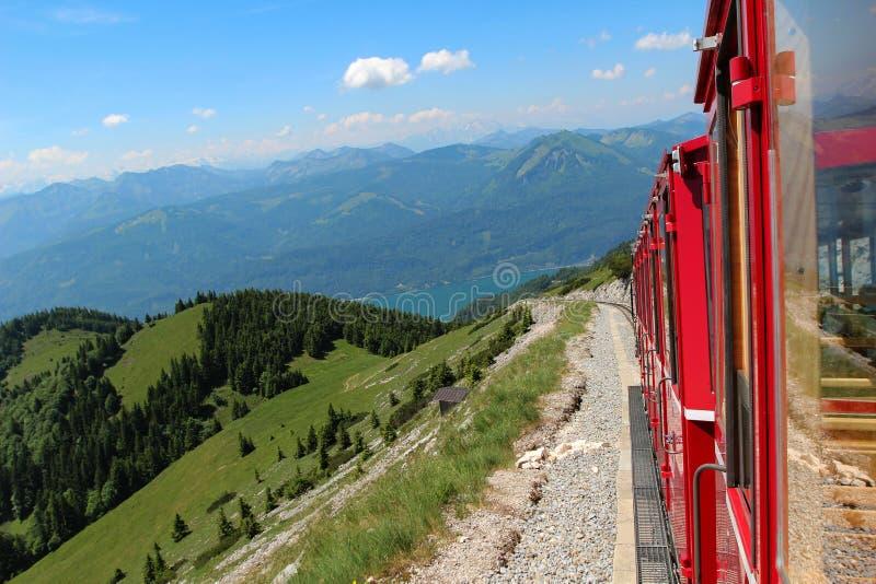 Beautiful mountain scenery in the Austrian Alps. Steam locomotive of a vintage cogwheel railway going to Schafberg, Wolfgangsee. Schafberg Peak - 1783m stock image