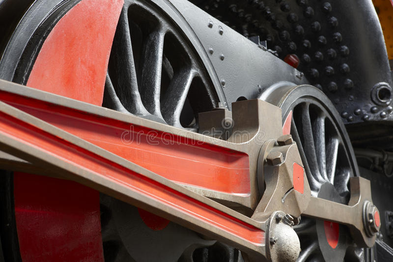 Steam locomotive wheel and connecting rod detail royalty free stock photo