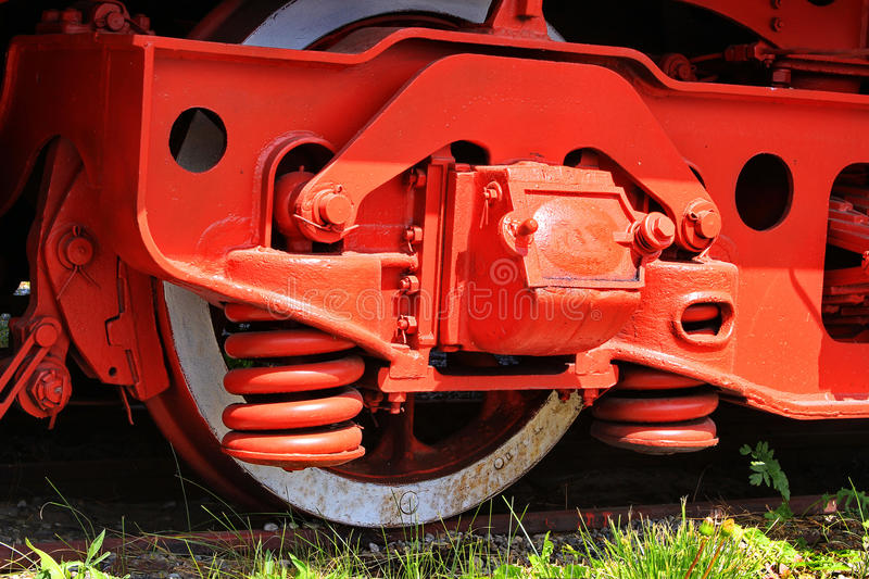 Red wheel and detail of mechanism a vintage romanian steam train locomotive royalty free stock photography
