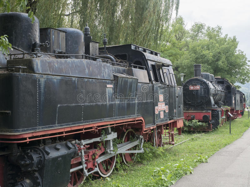 Steam locomotives museum, Resita, Romania. Old time steam train vintage locomotives displayed in the locomotives museum located in Resita, Romania. The museum royalty free stock photography