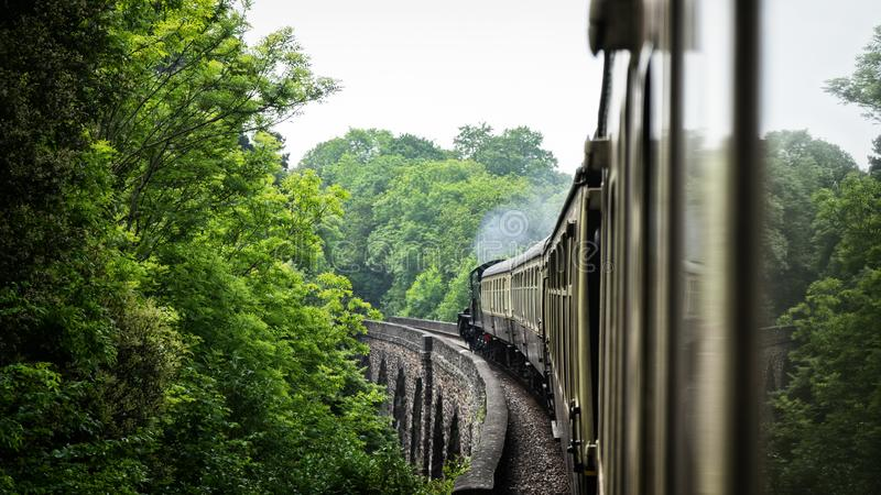 Steam old train on aqueduct bridge. united kingdom.  stock images