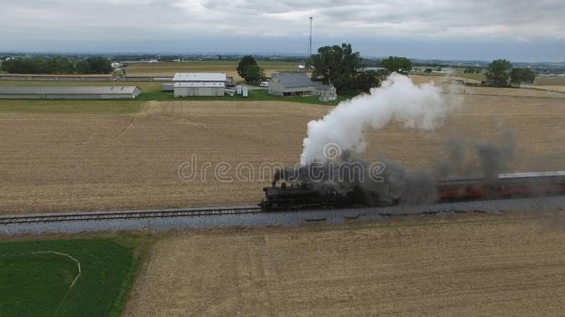 Steam Passenger Train Puffing Smoke in amish Countryside 17. Aerial View of a Steam Passenger Train Puffing Smoke in Amish Countrye on a Sunny Spring Day royalty free stock images