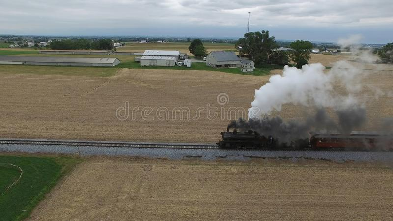 Steam Passenger Train Puffing Smoke in amish Countryside 16. Aerial View of a Steam Passenger Train Puffing Smoke in Amish Countrye on a Sunny Spring Day stock photos