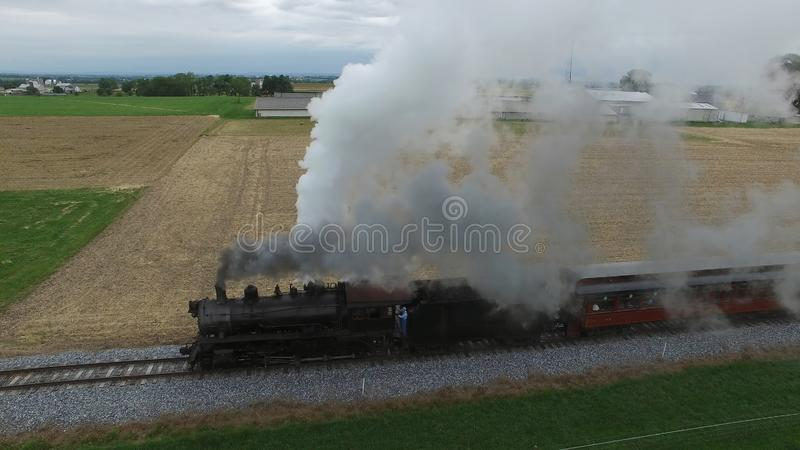 Steam Passenger Train Puffing Smoke in amish Countryside 20. Aerial View of a Steam Passenger Train Puffing Smoke in Amish Countrye on a Sunny Spring Day royalty free stock image