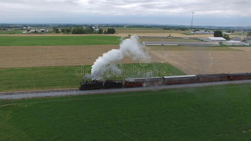 Steam Passenger Train Puffing Smoke in amish Countryside 21. Aerial View of a Steam Passenger Train Puffing Smoke in Amish Countrye on a Sunny Spring Day stock photography
