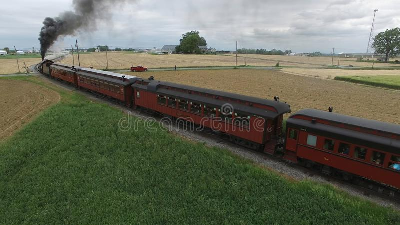 Steam Passenger Train Puffing Smoke in amish Countryside 5. Aerial View of a Steam Passenger Train Puffing Smoke in Amish Countryside on a Sunny Spring Day royalty free stock photos