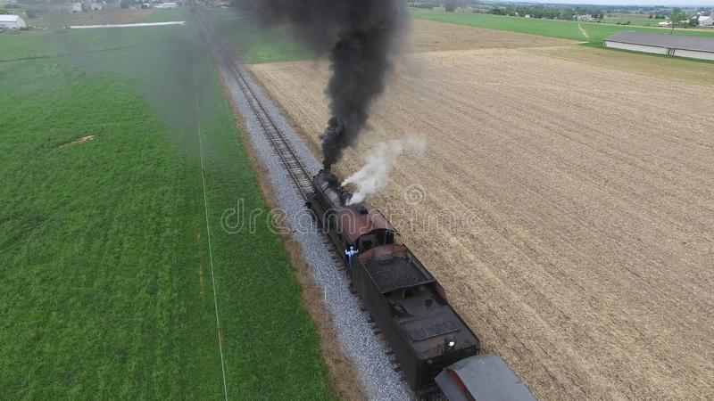 Steam Passenger Train Puffing Smoke in amish Countryside 10. Aerial View of a Steam Passenger Train Puffing Smoke in Amish Countryside on a Sunny Spring Day stock images