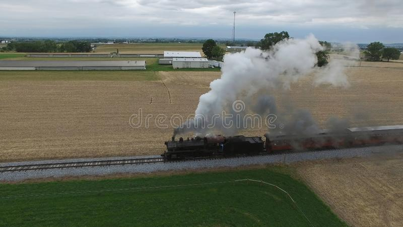 Steam Passenger Train Puffing Smoke in amish Countryside 18. Aerial View of a Steam Passenger Train Puffing Smoke in Amish Countryside on a Sunny Spring Day royalty free stock images