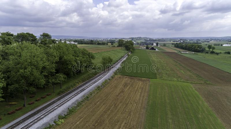 Steam Passenger Train Puffing Smoke in amish Countryside 28. Aerial View of a Steam Passenger Train Puffing Smoke in Amish Countryside on a Sunny Spring Day royalty free stock photos