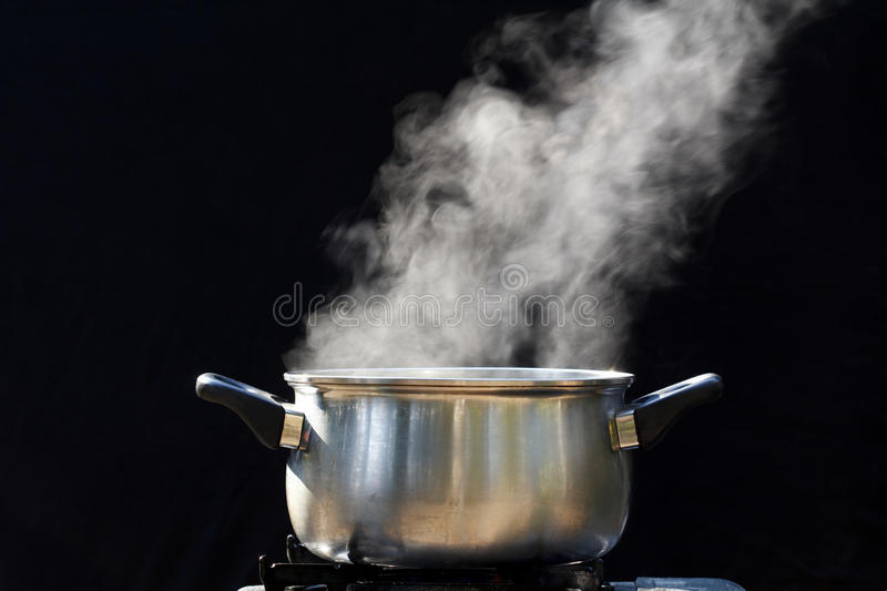 Steam on pot in kitchen. For background