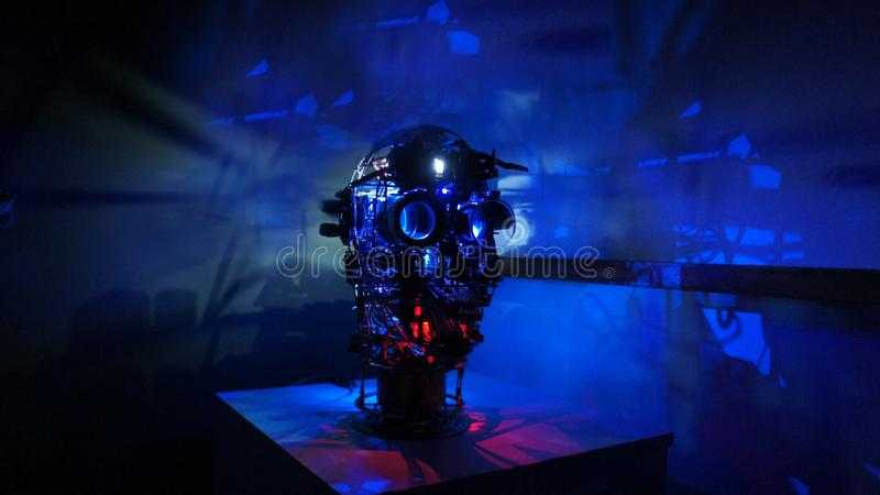 Steam punk metal robot head with blue background wide image stock images