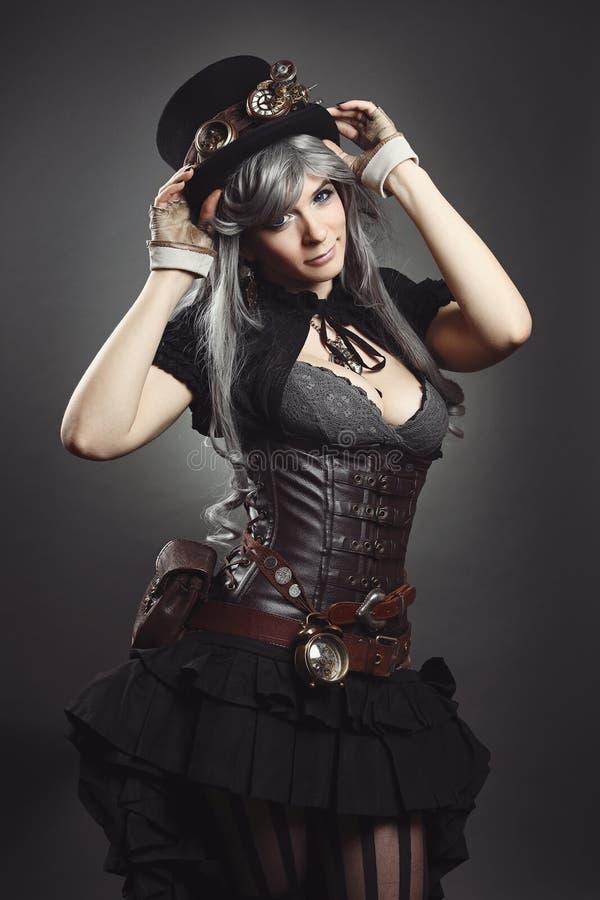 Steam punk dressed woman stock photo