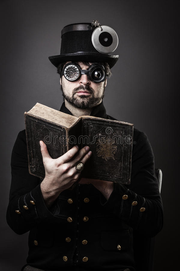 Steam punk man with book stock image