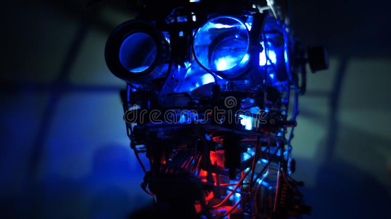Steam punk metal robot head with blue background close up royalty free stock photos