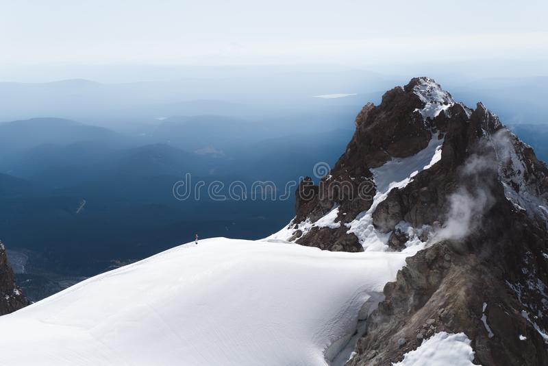 Steam rises from volcanic vents on the towering cliffs of Mt Hood stock images