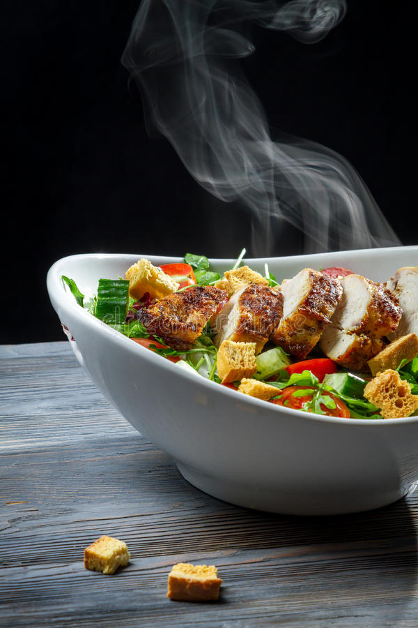 Steam rising from a freshly roasted chicken royalty free stock photo