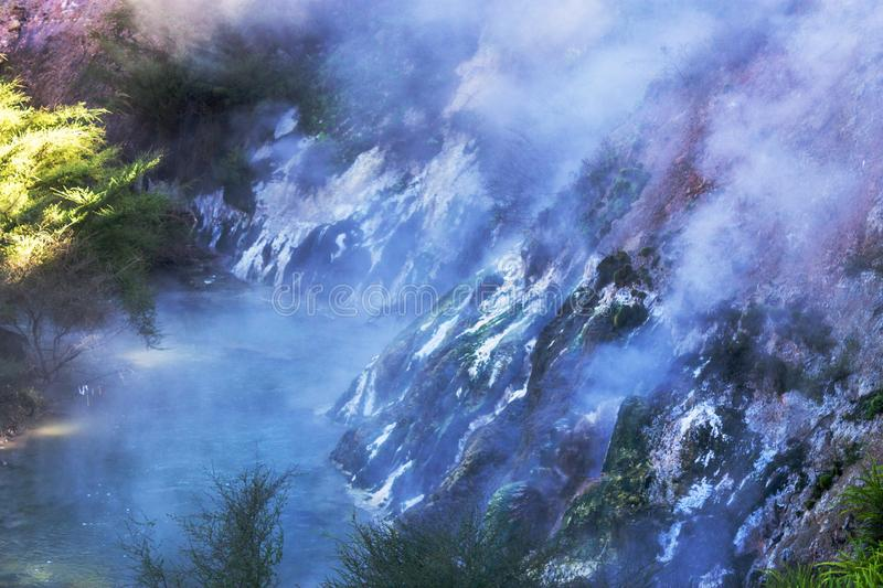 Steam rising from a geothermal river royalty free stock image