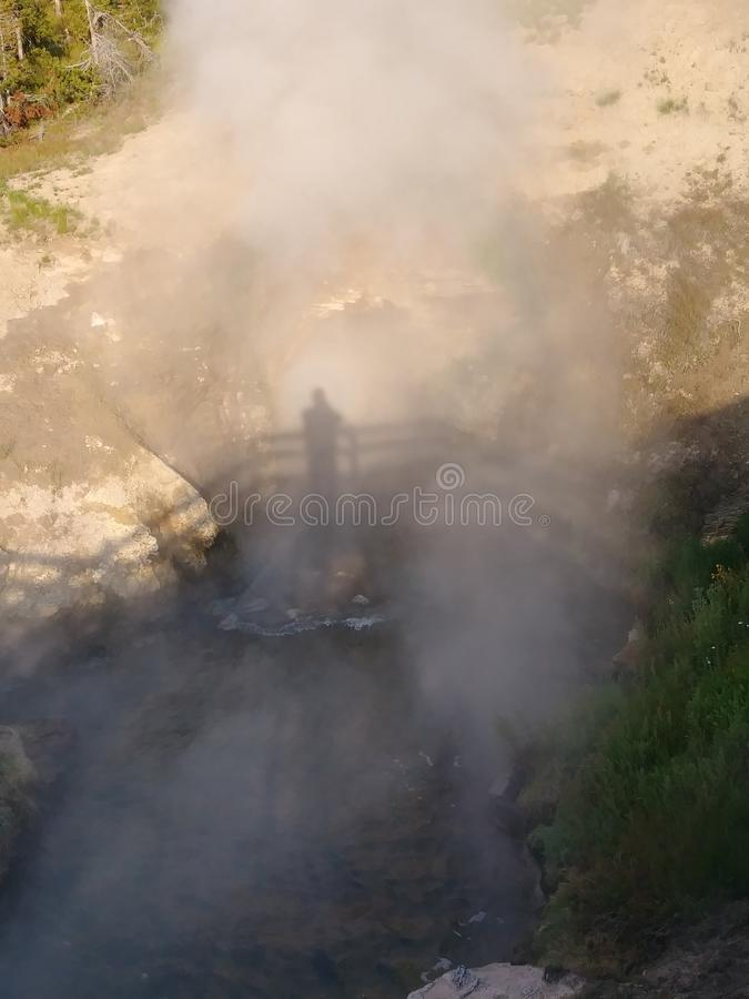 Steam rising in Yellowstone National Park. Steam rising from a volcanic feature in Yellowstone National Park royalty free stock photography