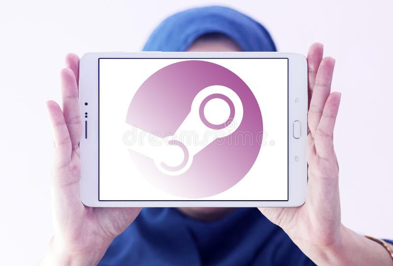 Steam games software company logo. Logo of Steam software company on samsung tablet holded by arab muslim woman. Steam is a digital distribution platform stock photos
