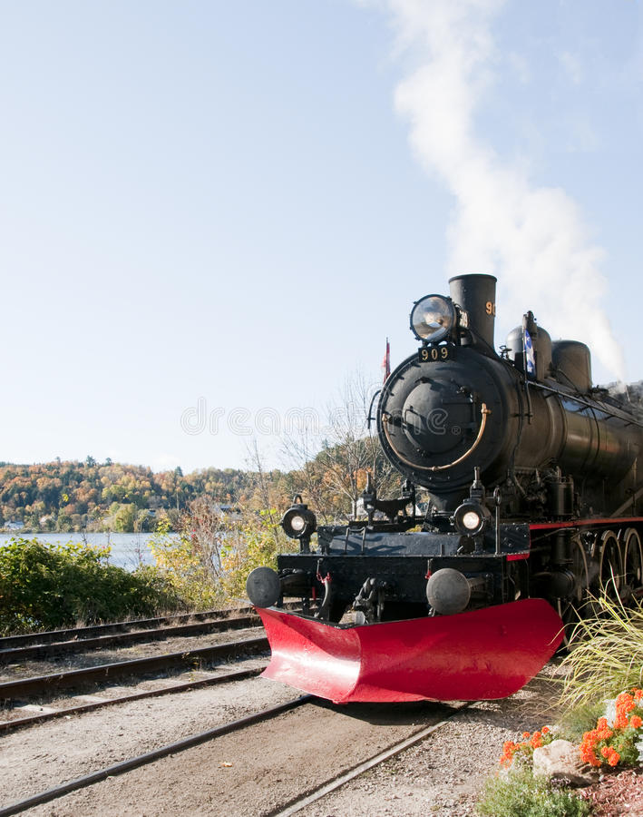 Steam train. On a fall day royalty free stock image