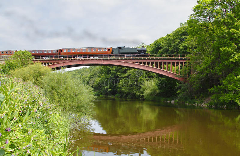 Steam train on bridge stock photography