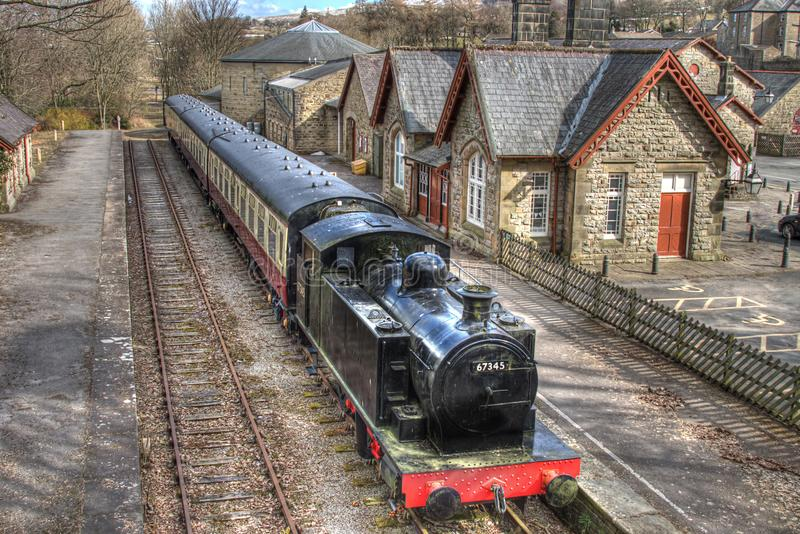 Steam train, Hawes, North Yorkshire. A steam train and coaches at the platform of the old Hawes railway station, part of the Dales Countrye Museum in Hawes stock photo