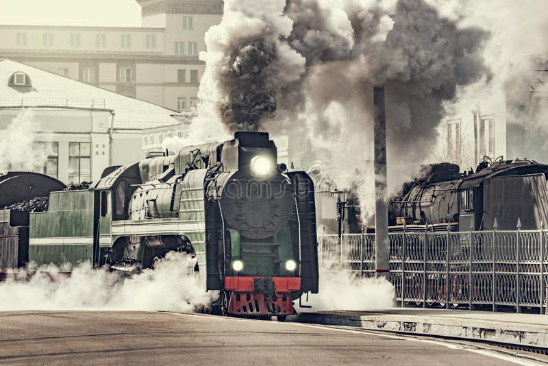 Steam train departs from the railway station royalty free stock image