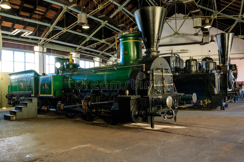 Steam train engines. LJUBLJANA, SLOVENIA - JUNE 20th 2015: Steam train engines parked in the railway museum stock photography