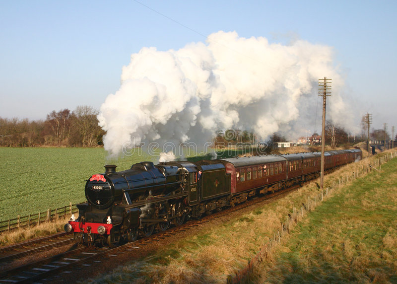 Steam Train in the English countryside stock images