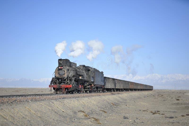 Steam train in the Gobi Desert stock photography
